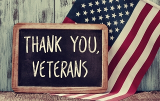 thank you veterans in a chalkboard and the flag of the US